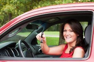 woman holding keys in car